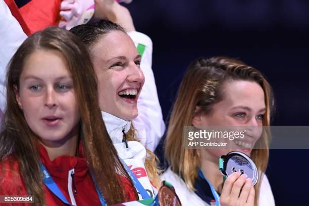 Silver medalist Spain's Mireia Belmonte gold medalist Hungary's Katinka Hosszu and bronze medalist Canada's Sydney Pickrem celebrate on the podium of...