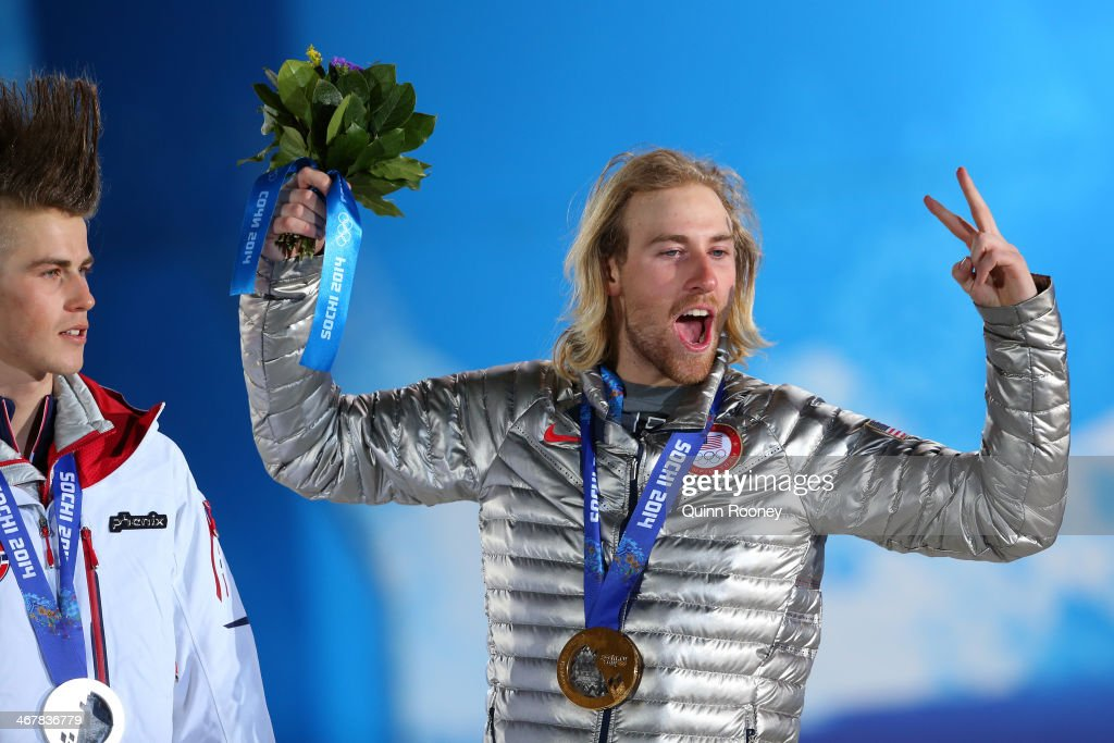 Silver medalist Staale Sandbech of Norway and gold medalist <a gi-track='captionPersonalityLinkClicked' href=/galleries/search?phrase=Sage+Kotsenburg&family=editorial&specificpeople=6711370 ng-click='$event.stopPropagation()'>Sage Kotsenburg</a> of the United States on the podium during the medal ceremony for the for the Snowboard Men's Slopestyle during day 1 of the Sochi 2014 Winter Olympics at Medals Plaza on February 8, 2014 in Sochi, Russia.