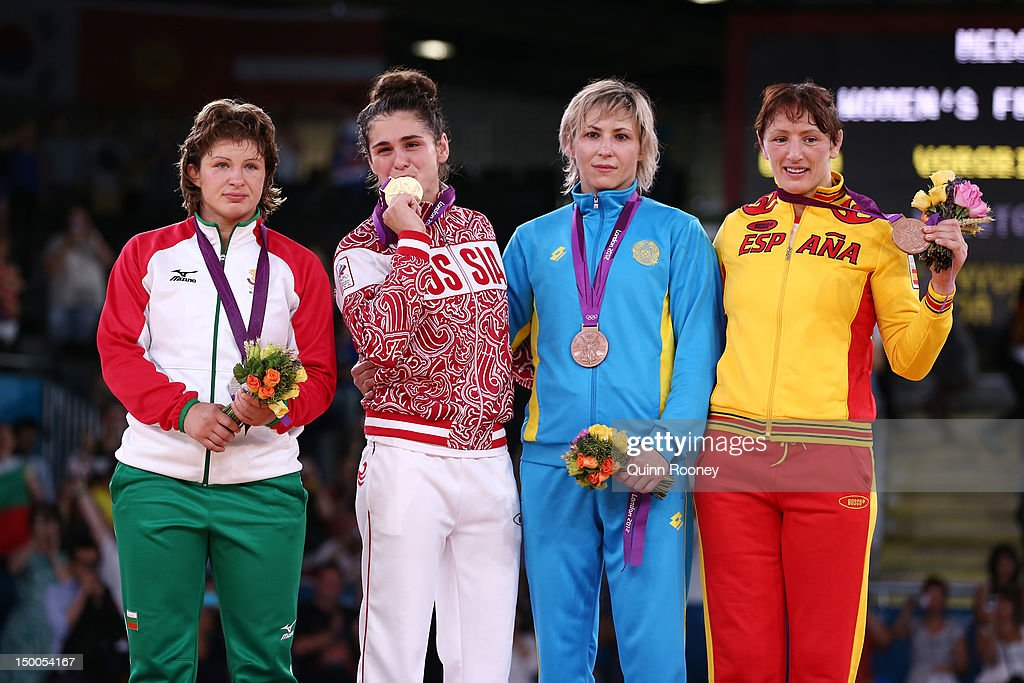 Silver medalist Stanka Zlateva Hristova of Bulgaria, Gold medalist Natalia Vorobeva of Russia, Bronze medalist Guzel Manyurova of Kazakhstan, and Bronze medalist Maider Unda Gonzalez De Audicana of Spain celebrate winning the silver medal in the Women's Freestyle 72 kg Wrestling on Day 13 of the London 2012 Olympic Games at ExCeL on August 9, 2012 in London, England.