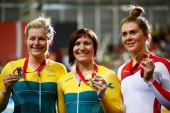 Silver medalist Stephanie Morton of Australia Gold medalist Anna Meares of Australia and bronze medalist Jess Varnish of England celebrate on the...
