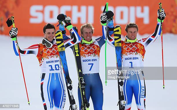 Silver medalist Steve Missillier of France gold medalist Ted Ligety of the United States and bronze medalist Alexis Pinturault of France celebrate...