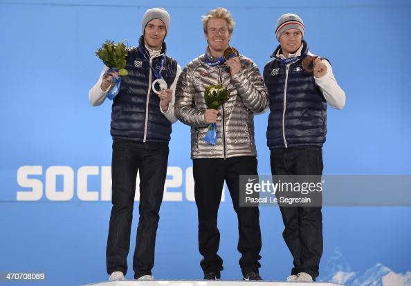 Silver medalist Steve Missillier of France gold medalist Ted Ligety of the United States and bronze medalist Alexis Pinturault of France celebrate on...
