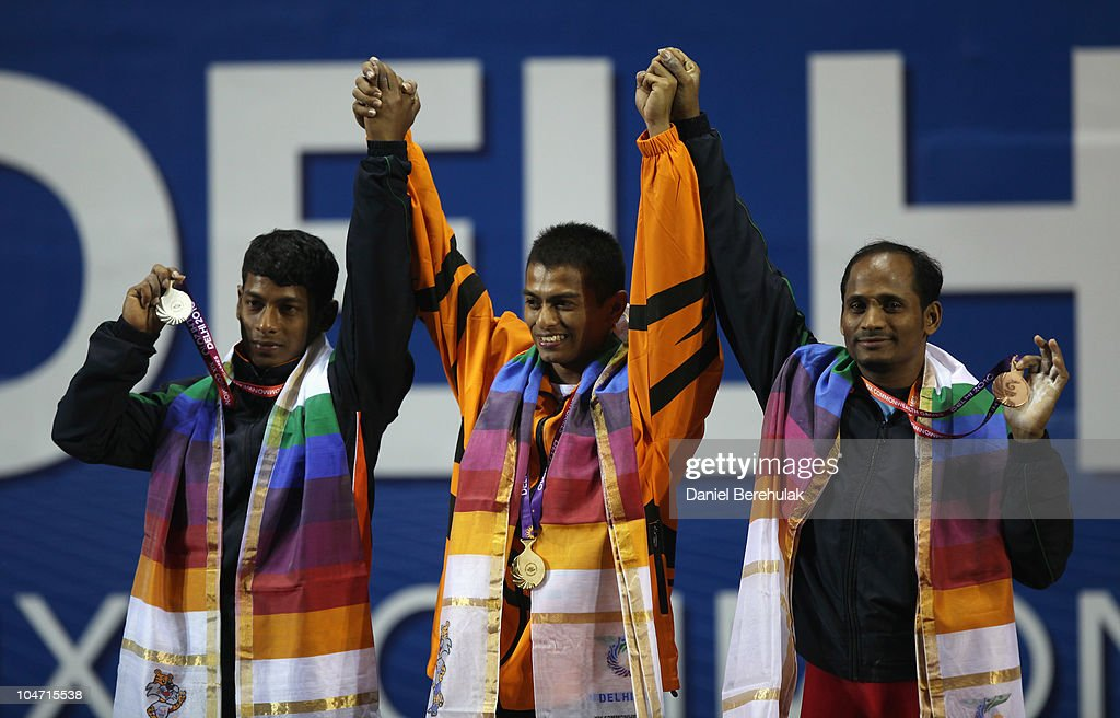 Silver medalist Sukhen Dey of India, gold medalist Hamizan Amirul Ibrahim of Malaysia and Srinivasa Rao Valluri of India pose during the presentation for the Mens 56 kg weightlifting final during day one of the Delhi 2010 Commonwealth Games at Jawaharlal Nehru Sports Complex on October 4, 2010 in Delhi, India.