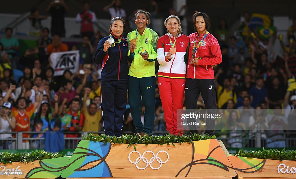 Silver medalist Sumiya Dorjsuren of Mongolia, gold medalist Rafaela Silva of Brazil, bronze medalist Telma Monteiro of Portugal and bronze medalist Kaori Matsumoto of Japan celebrate on the podium after the Women's -57 kg Judo Contest on Day 3 of the Rio 2016 Olympic Games at Carioca Arena 2 on August 8, 2016 in Rio de Janeiro, Brazil.
