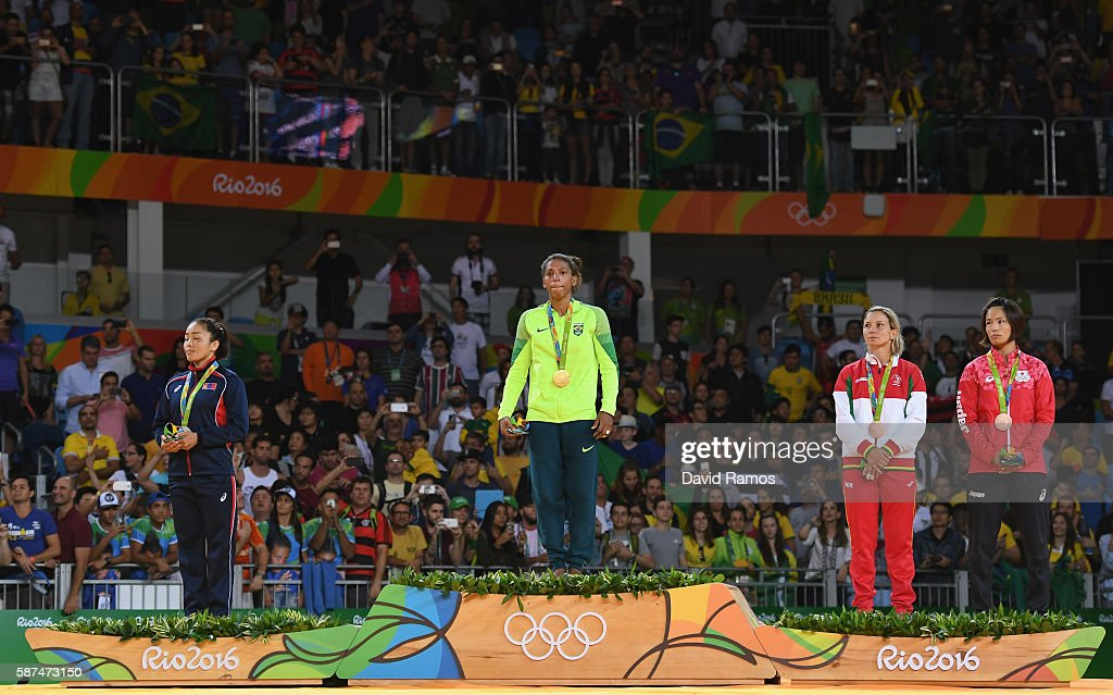 Silver medalist Sumiya Dorjsuren of Mongolia, gold medalist Rafaela Silva of Brazil, bronze medalist Telma Monteiro of Portugal and bronze medalist Kaori Matsumoto of Japan stand on the podium after the Women's -57 kg Judo Contest on Day 3 of the Rio 2016 Olympic Games at Carioca Arena 2 on August 8, 2016 in Rio de Janeiro, Brazil.
