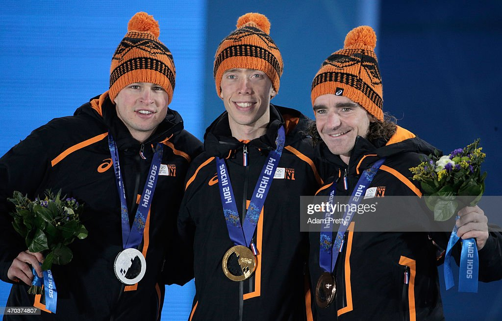 Silver medalist <a gi-track='captionPersonalityLinkClicked' href=/galleries/search?phrase=Sven+Kramer&family=editorial&specificpeople=769363 ng-click='$event.stopPropagation()'>Sven Kramer</a> of the Netherlands, gold medalist <a gi-track='captionPersonalityLinkClicked' href=/galleries/search?phrase=Jorrit+Bergsma&family=editorial&specificpeople=7364017 ng-click='$event.stopPropagation()'>Jorrit Bergsma</a> of the Netherlands and bronze medalist <a gi-track='captionPersonalityLinkClicked' href=/galleries/search?phrase=Bob+de+Jong&family=editorial&specificpeople=822252 ng-click='$event.stopPropagation()'>Bob de Jong</a> of the Netherlands celebrate on the podium during the medal ceremony for the Men's 10000m Speed Skating on day twelve of the Sochi 2014 Winter Olympics at at Medals Plaza on February 19, 2014 in Sochi, Russia.