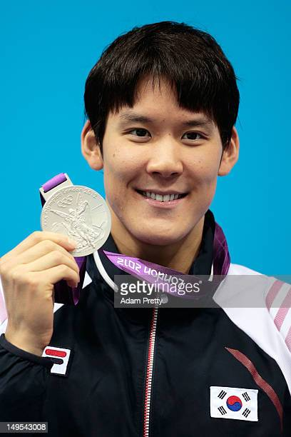Silver medalist TaeHwan Park of Korea celebrates with his medal during the medal ceremony for the Men's 200m Freestyle on Day 3 of the London 2012...