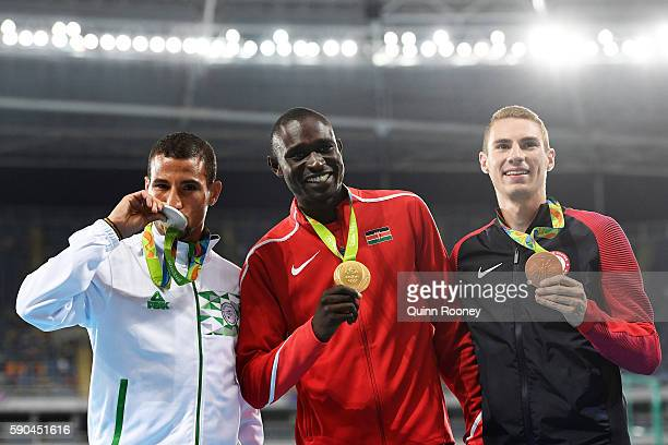 Silver medalist Taoufik Makhloufi of Algeria gold medalist David Lekuta Rudisha of Kenya and bronze medalist Clayton Murphy of the United States pose...