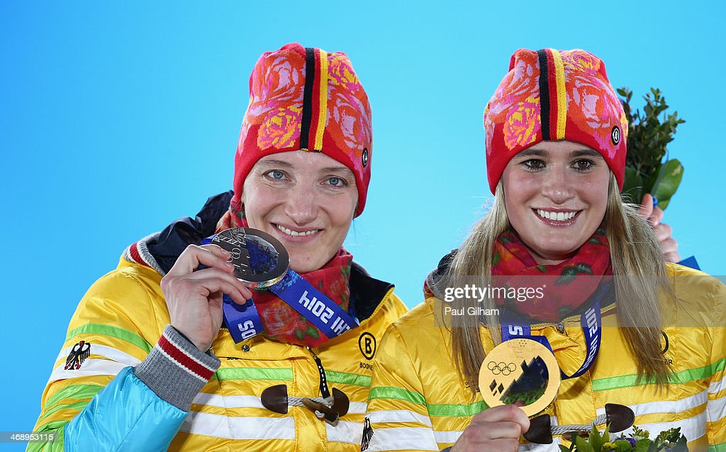 Silver medalist <a gi-track='captionPersonalityLinkClicked' href=/galleries/search?phrase=Tatjana+Huefner&family=editorial&specificpeople=702799 ng-click='$event.stopPropagation()'>Tatjana Huefner</a> of Germany (L) and gold medalist <a gi-track='captionPersonalityLinkClicked' href=/galleries/search?phrase=Natalie+Geisenberger&family=editorial&specificpeople=4698568 ng-click='$event.stopPropagation()'>Natalie Geisenberger</a> of Germany celebrate on the podium during the medal ceremony for Women's Luge Singles on day five of the Sochi 2014 Winter Olympics at Medals Plaza on February 12, 2014 in Sochi, Russia.