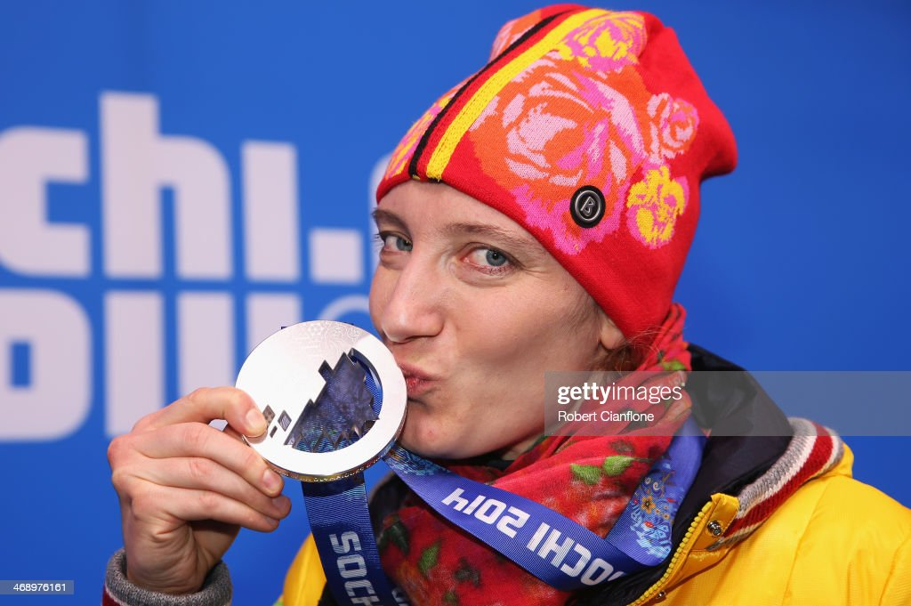 Silver medalist <a gi-track='captionPersonalityLinkClicked' href=/galleries/search?phrase=Tatjana+Huefner&family=editorial&specificpeople=702799 ng-click='$event.stopPropagation()'>Tatjana Huefner</a> of Germany celebrates during the medal for the Women's Luge Singles on day five of the Sochi 2014 Winter Olympics at Medals Plaza on February 12, 2014 in Sochi, Russia.