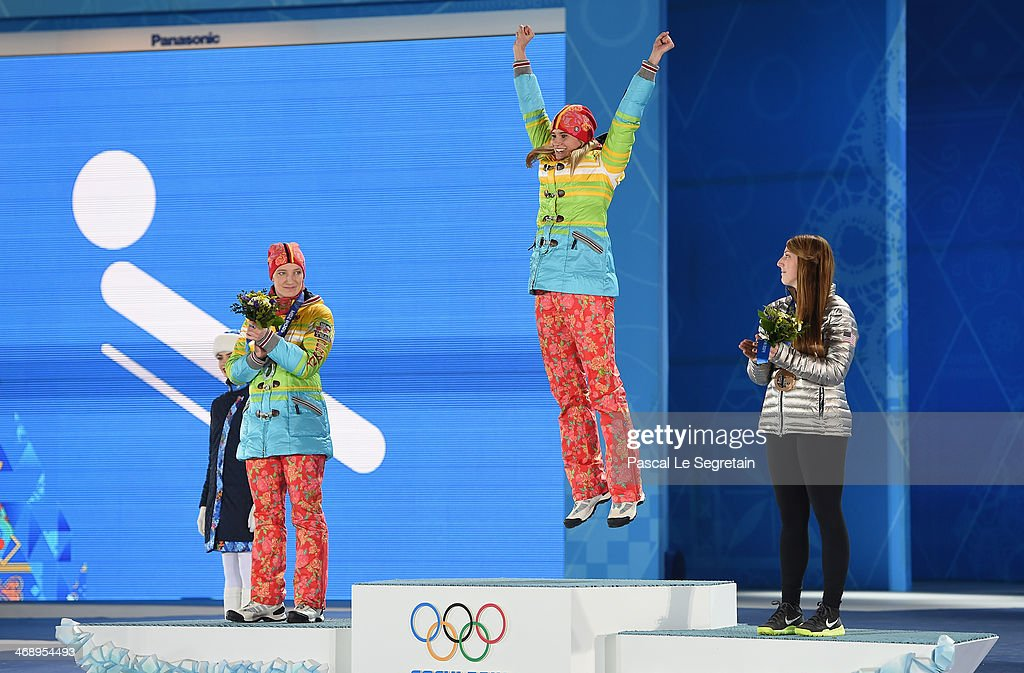 Silver medalist Tatjana Huefner of Germany, gold medalist Natalie Geisenberger of Germany and bronze medalist Erin Hamlin of the United States celebrate on the podium during the medal ceremony for Women's Luge Singles on day five of the Sochi 2014 Winter Olympics at Medals Plaza on February 12, 2014 in Sochi, Russia.