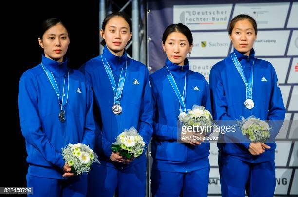 Silver medalist team of South Korea stand on the podium after plced second in the team women's sabre final between South Korea and Italy at the World...