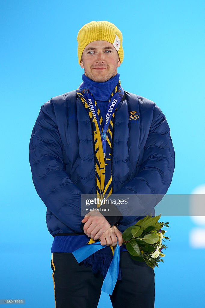 Silver medalist <a gi-track='captionPersonalityLinkClicked' href=/galleries/search?phrase=Teodor+Peterson&family=editorial&specificpeople=6567370 ng-click='$event.stopPropagation()'>Teodor Peterson</a> of Sweden celebrates during the medal for the Men's Sprint Free on day five of the Sochi 2014 Winter Olympics at Medals Plaza on February 12, 2014 in Sochi, Russia.