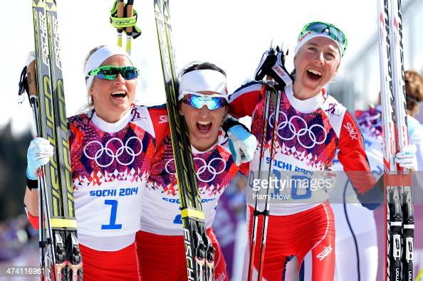 Silver medalist Therese Johaug of Norway gold medalist Marit Bjoergen of Norway and bronze medalist Kristin Stoermer Steira of Norway celebrate after...