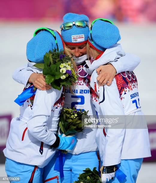 Silver medalist Therese Johaug of Norway gold medalist Marit Bjoergen of Norway and bronze medalist Kristin Stoermer Steira of Norway celebrate...