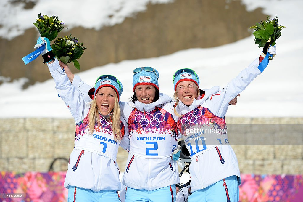 Silver medalist <a gi-track='captionPersonalityLinkClicked' href=/galleries/search?phrase=Therese+Johaug&family=editorial&specificpeople=4176080 ng-click='$event.stopPropagation()'>Therese Johaug</a> of Norway, gold medalist <a gi-track='captionPersonalityLinkClicked' href=/galleries/search?phrase=Marit+Bjoergen&family=editorial&specificpeople=216406 ng-click='$event.stopPropagation()'>Marit Bjoergen</a> of Norway and bronze medalist <a gi-track='captionPersonalityLinkClicked' href=/galleries/search?phrase=Kristin+Stoermer+Steira&family=editorial&specificpeople=4137577 ng-click='$event.stopPropagation()'>Kristin Stoermer Steira</a> of Norway celebrate during the flower ceremony for the Women's 30 km Mass Start Free during day 15 of the Sochi 2014 Winter Olympics at Laura Cross-country Ski & Biathlon Center on February 22, 2014 in Sochi, Russia.