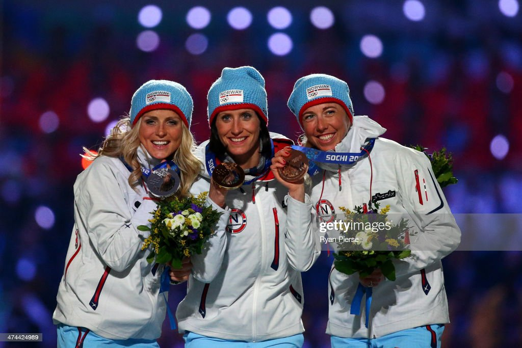 Silver medalist <a gi-track='captionPersonalityLinkClicked' href=/galleries/search?phrase=Therese+Johaug&family=editorial&specificpeople=4176080 ng-click='$event.stopPropagation()'>Therese Johaug</a> of Norway, gold medalist <a gi-track='captionPersonalityLinkClicked' href=/galleries/search?phrase=Marit+Bjoergen&family=editorial&specificpeople=216406 ng-click='$event.stopPropagation()'>Marit Bjoergen</a> of Norway and bronze medalist <a gi-track='captionPersonalityLinkClicked' href=/galleries/search?phrase=Kristin+Stoermer+Steira&family=editorial&specificpeople=4137577 ng-click='$event.stopPropagation()'>Kristin Stoermer Steira</a> of Norway celebrate in the medal ceremony for the Women's 30 km Mass Start Free during the 2014 Sochi Winter Olympics Closing Ceremony at Fisht Olympic Stadium on February 23, 2014 in Sochi, Russia.
