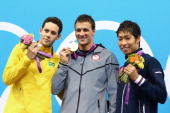 Silver medalist Thiago Pereira of Brazil Gold medalist Ryan Lochte of the United States and Bronze medalist Kosuke Hagino of Japan celebrate with...