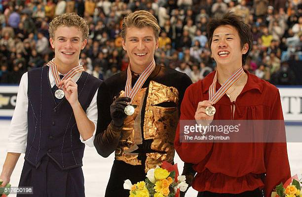 Silver medalist Timothy Goebel of the United States gold medalist Alexei Yagudin of Russia and bronze medalist Takeshi Honda of Japan pose for...