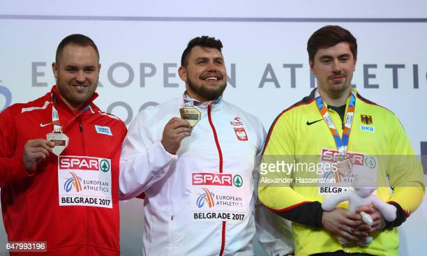 Silver medalist Tomas Stanek of Czech Republic gold medalist Konrad Bukowiecki of Poland and bronze medalist David Storl of Germany pose during the...