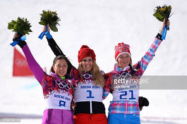 Silver medalist Tomoka Takeuchi of Japan gold medalist Patrizia Kummer of Switzerland and bronze medalist Alena Zavarzina of Russia celebrate on the...