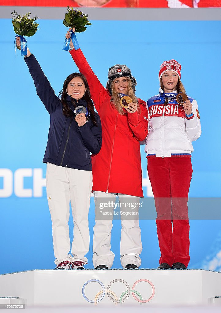 Silver medalist <a gi-track='captionPersonalityLinkClicked' href=/galleries/search?phrase=Tomoka+Takeuchi&family=editorial&specificpeople=6719453 ng-click='$event.stopPropagation()'>Tomoka Takeuchi</a> of Japan, gold medalist <a gi-track='captionPersonalityLinkClicked' href=/galleries/search?phrase=Patrizia+Kummer&family=editorial&specificpeople=4126268 ng-click='$event.stopPropagation()'>Patrizia Kummer</a> of Switzerland and bronze medalist <a gi-track='captionPersonalityLinkClicked' href=/galleries/search?phrase=Alena+Zavarzina&family=editorial&specificpeople=6598104 ng-click='$event.stopPropagation()'>Alena Zavarzina</a> of Russia celebrate on the podium during the medal ceremony for the Women's Parallel Giant Slalom on day twelve of the Sochi 2014 Winter Olympics at at Medals Plaza on February 19, 2014 in Sochi, Russia.