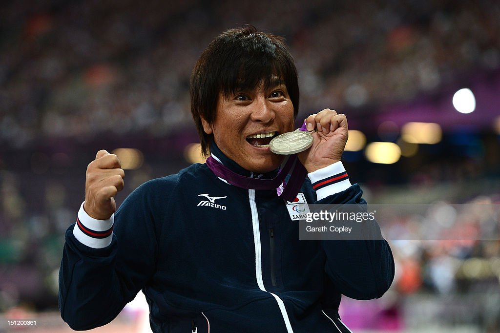 Silver medalist Tomoya Ito of Japan poses on the podium during the medal ceremony for the Men's 400m - T52 Final on day 5 of the London 2012 Paralympic Games at Olympic Stadium on September 3, 2012 in London, England.