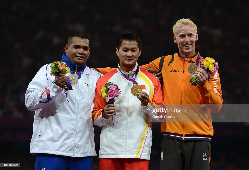 Silver medalist Tony Falelavaki of France, gold medalist Mingjie Gao of China and bronze medalist Ronald Hertog of Netherlands pose on the podium during the medal ceremony for the Men's Javelin Throw - F44 on day 4 of the London 2012 Paralympic Games at Olympic Stadium on September 2, 2012 in London, England.