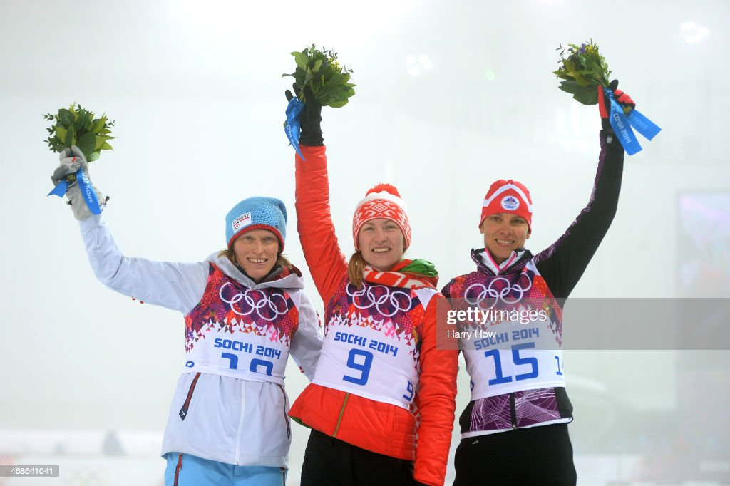 Silver medalist <a gi-track='captionPersonalityLinkClicked' href=/galleries/search?phrase=Tora+Berger&family=editorial&specificpeople=812729 ng-click='$event.stopPropagation()'>Tora Berger</a> of Norway, gold medalist <a gi-track='captionPersonalityLinkClicked' href=/galleries/search?phrase=Darya+Domracheva&family=editorial&specificpeople=4105955 ng-click='$event.stopPropagation()'>Darya Domracheva</a> of Belarus and bronze medalist <a gi-track='captionPersonalityLinkClicked' href=/galleries/search?phrase=Teja+Gregorin&family=editorial&specificpeople=876933 ng-click='$event.stopPropagation()'>Teja Gregorin</a> of Slovenia stand on the podium during the flower ceremony for the the Women's 10 km Pursuit during day four of the Sochi 2014 Winter Olympics at Laura Cross-country Ski & Biathlon Center on February 11, 2014 in Sochi, Russia.