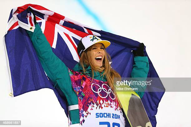 Silver medalist Torah Bright of Australia celebrates during the flower ceremony for the Snowboard Women's Halfpipe Finals on day five of the Sochi...