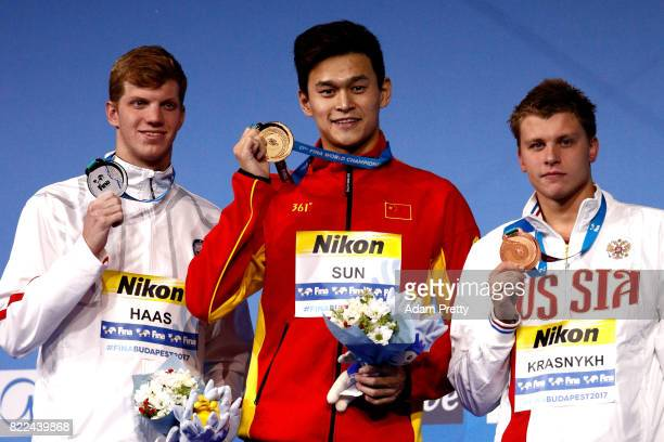 Silver medalist Townley Haas of the United States gold medalist Yang Sun of China and bronze medalist Aleksandr Krasnykh of Russia pose with the...