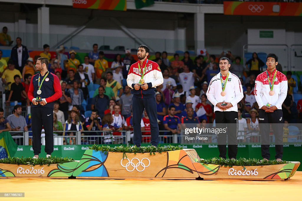 Silver medalist Travis Stevens of the United States gold medalist Khasan Khalmurzaev of Russia and bronze medalists Sergiu Toma of United Arab...