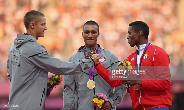 Silver medalist Trey Hardee of the United States gold medalist Ashton Eaton of the United States and bronze medalist Leonel Suarez of Cuba pose on...