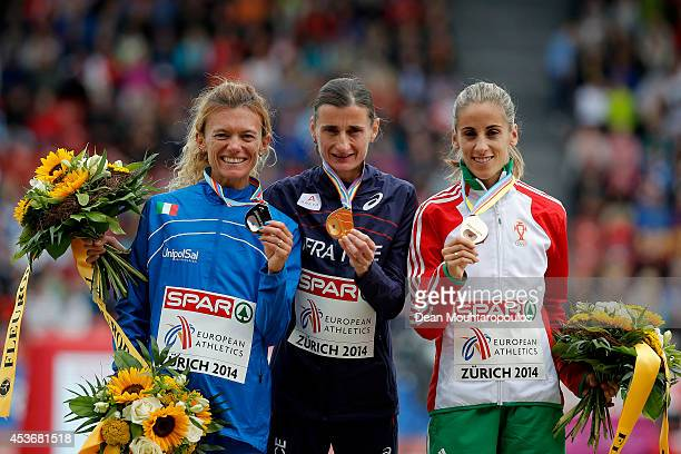 Silver medalist Valeria Straneo of Italy gold medalist Christelle Daunay of France and bronze medalist Jessica Augusto of Portugal pose with their...