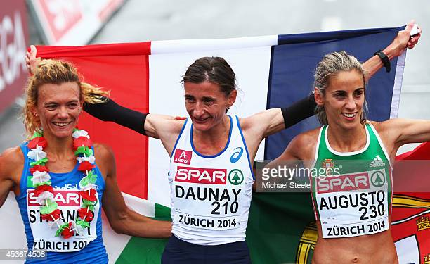Silver medalist Valerio Straneo of Italy gold medalist Christelle Daunay of France and bronze medalist Jessica Augusto of Portugal celebrate after...