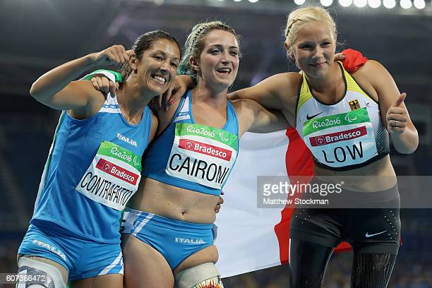 Silver medalist Vanessa Low of Germany gold medalist Martina Caironi of Italy and bronze medalist Monica Graziana Contrafatto of Italy celebrate...