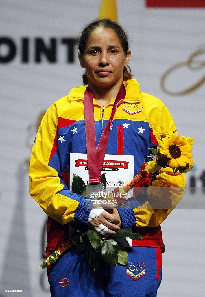 Silver medalist Venezuela's Mayelis Yesenia Caripa Castillo listens national anthem on the podium of the women's free style 48 kg category of the World Wrestling Championships in Budapest on September 18, 2013. AFP PHOTO / FERENC ISZA