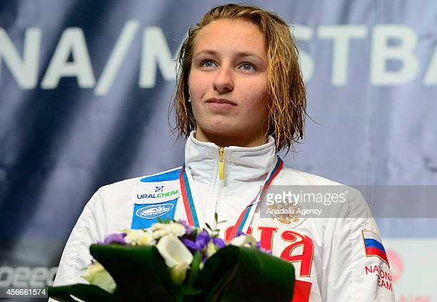 Silver medalist Veronika Popova of Russia poses on the podium after the Women's 200meter Freestyle final at the 2014 FINA Swimming World Cup at the...