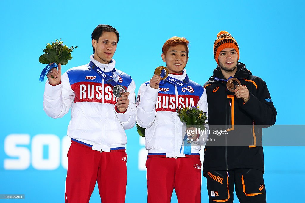 Silver medalist <a gi-track='captionPersonalityLinkClicked' href=/galleries/search?phrase=Vladimir+Grigorev&family=editorial&specificpeople=8717249 ng-click='$event.stopPropagation()'>Vladimir Grigorev</a> of Russia, gold medalist Victor An of Russia and bronze medalist <a gi-track='captionPersonalityLinkClicked' href=/galleries/search?phrase=Sjinkie+Knegt&family=editorial&specificpeople=5581263 ng-click='$event.stopPropagation()'>Sjinkie Knegt</a> of the Netherlands on the podium during the medal ceremony for Short Track Speed Skating Menfs 1000m on day 8 of the Sochi 2014 Winter Olympics at Medals Plaza on February 15, 2014 in Sochi, Russia.
