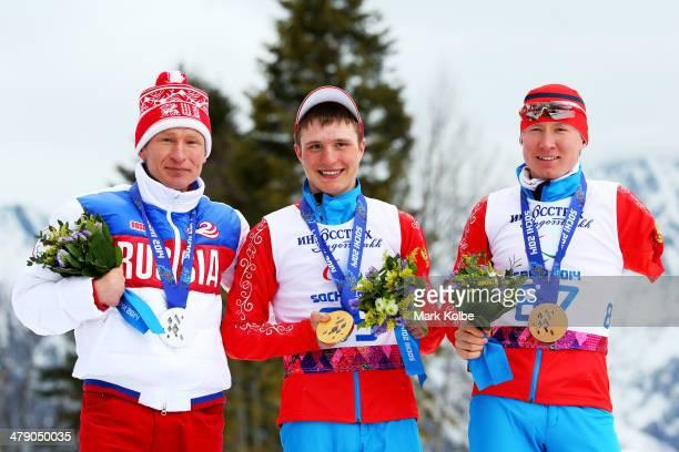 Silver medalist Vladimir Kononov of Russia gold medalist Aleksandr Pronkov of Russia and bronze medalist Vladislav Lekomtcev of Russia pose during...