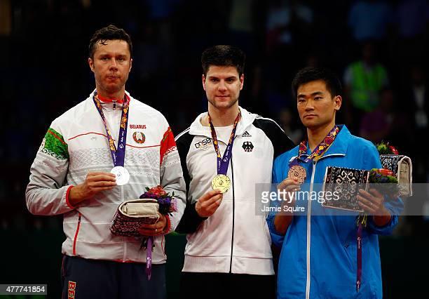Silver medalist Vladimir Samsonov of Belarus gold medalist Dimitrij Ovtcharov of Germany and bronze medalist Lei Kou of Ukraine stand on the podium...