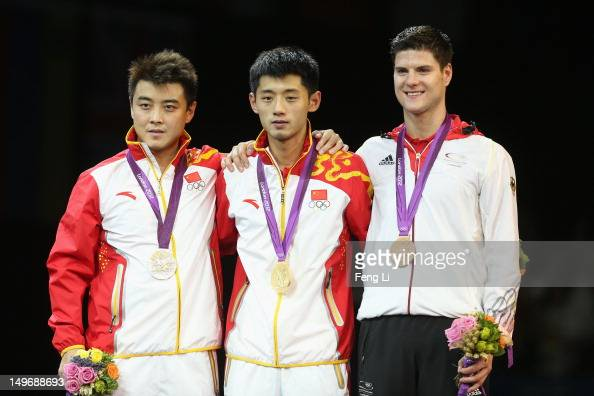 Silver medalist Wang Hao of China gold medalist Zhang Jike of China and bronze medalist Dimitrij Ovtcharov of Germany pose on the podium during the...