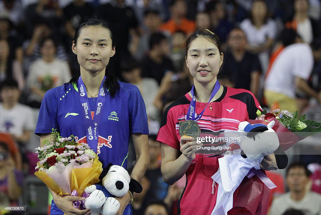 Silver medalist <a gi-track='captionPersonalityLinkClicked' href=/galleries/search?phrase=Wang+Yihan+-+Badminton+Player&family=editorial&specificpeople=9613872 ng-click='$event.stopPropagation()'>Wang Yihan</a> of China and gold medalist <a gi-track='captionPersonalityLinkClicked' href=/galleries/search?phrase=Sung+Ji-Hyun&family=editorial&specificpeople=6932412 ng-click='$event.stopPropagation()'>Sung Ji-Hyun</a> of South Korea pose on the podium after the Women's Singles final match of the 2015 Viktor Korea Badminton Open on September 20, 2015 in Seoul, South Korea.