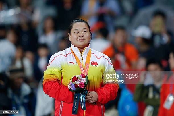 Silver medalist Wang Zheng of China pose on the podium during the victory ceremony for the Women's Hammer Throw during day nine of the 2014 Asian...