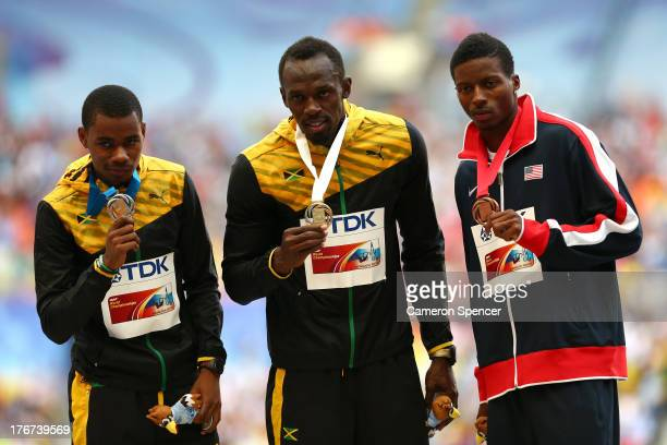 Silver medalist Warren Weir of Jamaica gold medalist Usain Bolt of Jamaica and bronze medalist Curtis Mitchell of the United States stand on the...