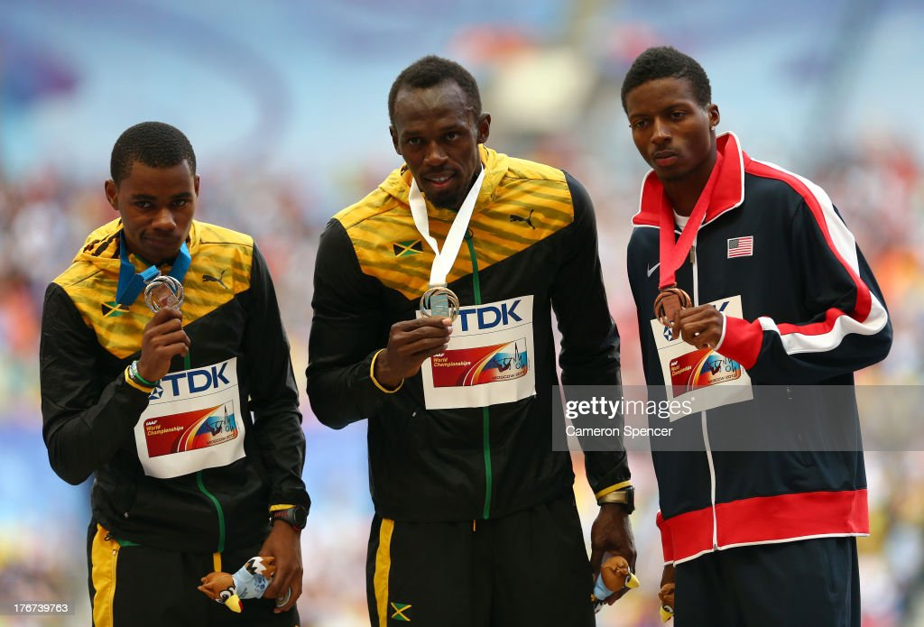 Silver medalist <a gi-track='captionPersonalityLinkClicked' href=/galleries/search?phrase=Warren+Weir&family=editorial&specificpeople=9482526 ng-click='$event.stopPropagation()'>Warren Weir</a> of Jamaica, gold medalist <a gi-track='captionPersonalityLinkClicked' href=/galleries/search?phrase=Usain+Bolt&family=editorial&specificpeople=604196 ng-click='$event.stopPropagation()'>Usain Bolt</a> of Jamaica and bronze medalist Curtis Mitchell of the United States stand on the podium during the medal ceremony for the Men's 200 metres during Day Nine of the 14th IAAF World Athletics Championships Moscow 2013 at Luzhniki Stadium on August 18, 2013 in Moscow, Russia.