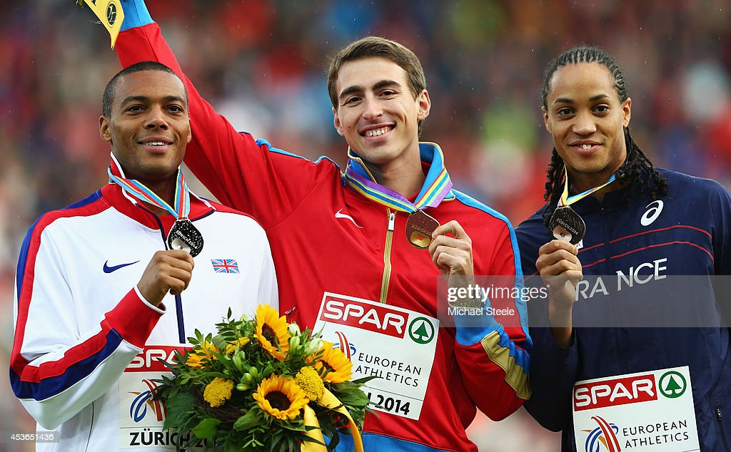 Silver medalist William Sharman of Great Britain and Northern Ireland, gold medalist <a gi-track='captionPersonalityLinkClicked' href=/galleries/search?phrase=Sergey+Shubenkov&family=editorial&specificpeople=8099833 ng-click='$event.stopPropagation()'>Sergey Shubenkov</a> of Russia and bronze medalist <a gi-track='captionPersonalityLinkClicked' href=/galleries/search?phrase=Pascal+Martinot-Lagarde&family=editorial&specificpeople=7114926 ng-click='$event.stopPropagation()'>Pascal Martinot-Lagarde</a> of France stand on the podium during the medal ceremony for the Men's 110 metres Hurdles metres final during day four of the 22nd European Athletics Championships at Stadium Letzigrund on August 15, 2014 in Zurich, Switzerland.
