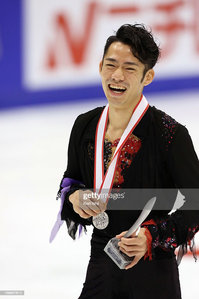 Silver medalist winner Daisuke Takahashi poses for photographs at the medal ceremony during day two of the 81st Japan Figure Skating Championships at Makomanai Sekisui Heim Ice Arena on December 22, 2012 in Sapporo, Japan.