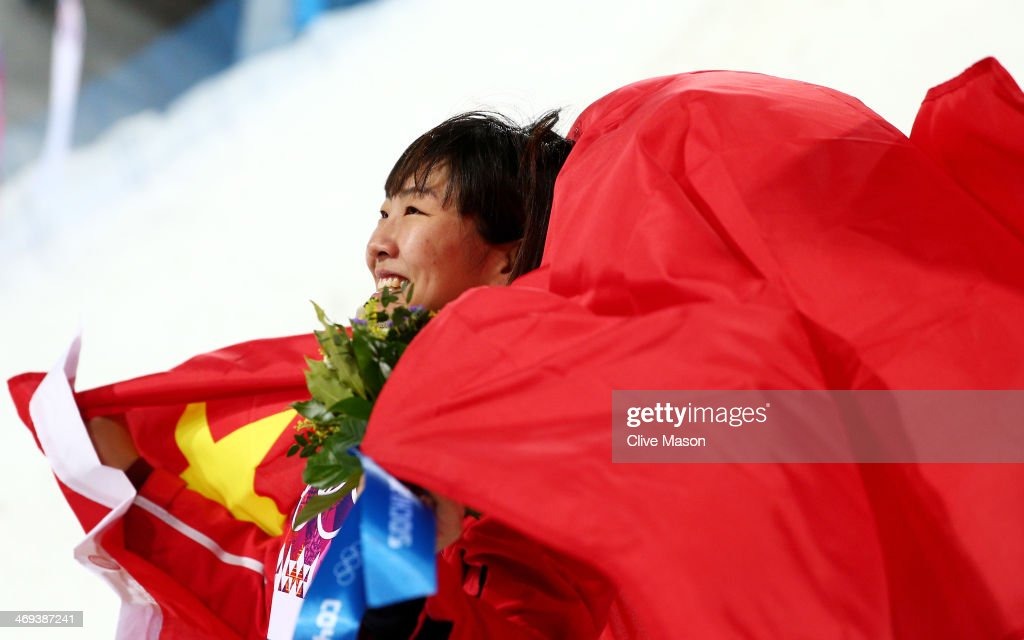 Silver medalist <a gi-track='captionPersonalityLinkClicked' href=/galleries/search?phrase=Xu+Mengtao&family=editorial&specificpeople=4131456 ng-click='$event.stopPropagation()'>Xu Mengtao</a> of China celebrates during the flower ceremony for the Freestyle Skiing Ladies' Aerials Finals on day seven of the Sochi 2014 Winter Olympics at Rosa Khutor Extreme Park on February 14, 2014 in Sochi, Russia.