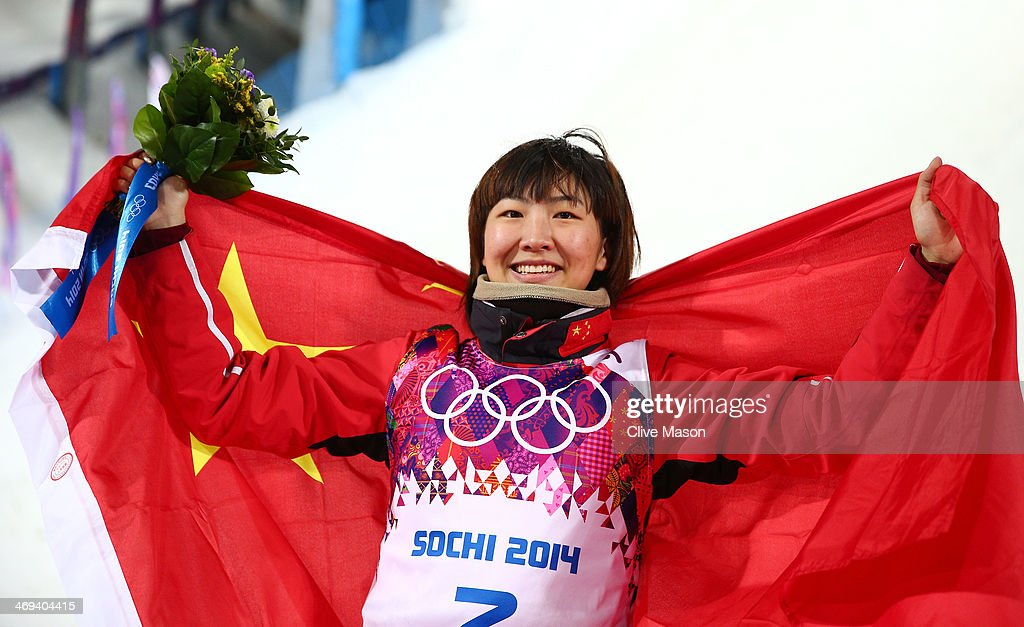 Silver medalist Xu Mengtao of China celebrates during the flower ceremony for the Freestyle Skiing Ladies' Aerials Finals on day seven of the Sochi 2014 Winter Olympics at Rosa Khutor Extreme Park on February 14, 2014 in Sochi, Russia.